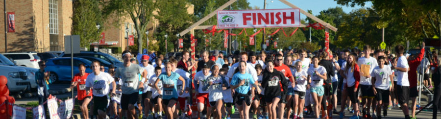 Runners take off from the school at last year's Habitat for Humanity Race. This year's race will take place on Sunday, Sept. 18.