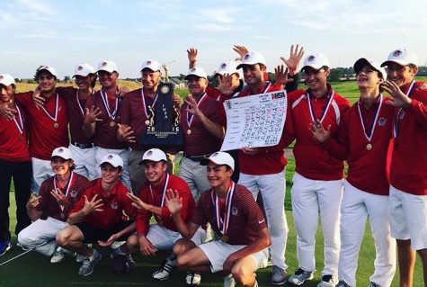 The team holds the scorecard and the trophy as they celebrate the win at State on Oct. 15.