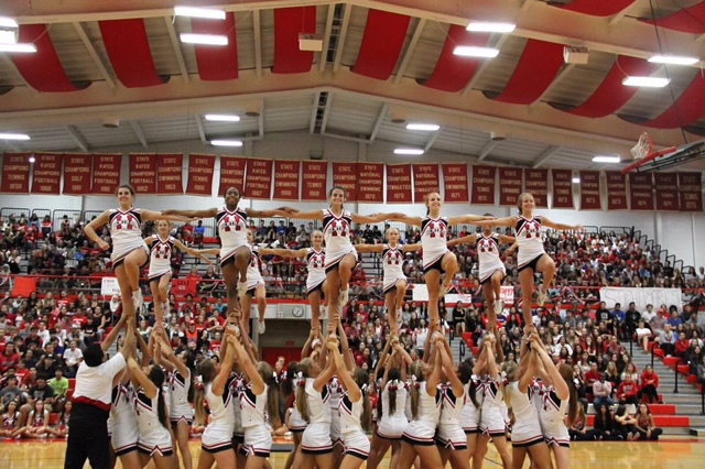 The+JV+and+Varsity+cheerleaders+performed+during+the+Homecoming+pep+rally+on+Sep.+30.