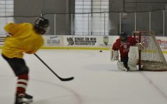 Central varsity hockey players gear up in practice to face rival Lyons Township on Oct. 7.
