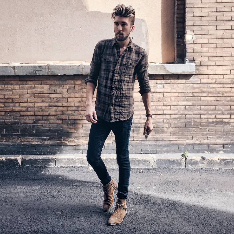 Thomas Trust, Chicago menswear blogger, pairs a plaid flannel with jeans and boots.
