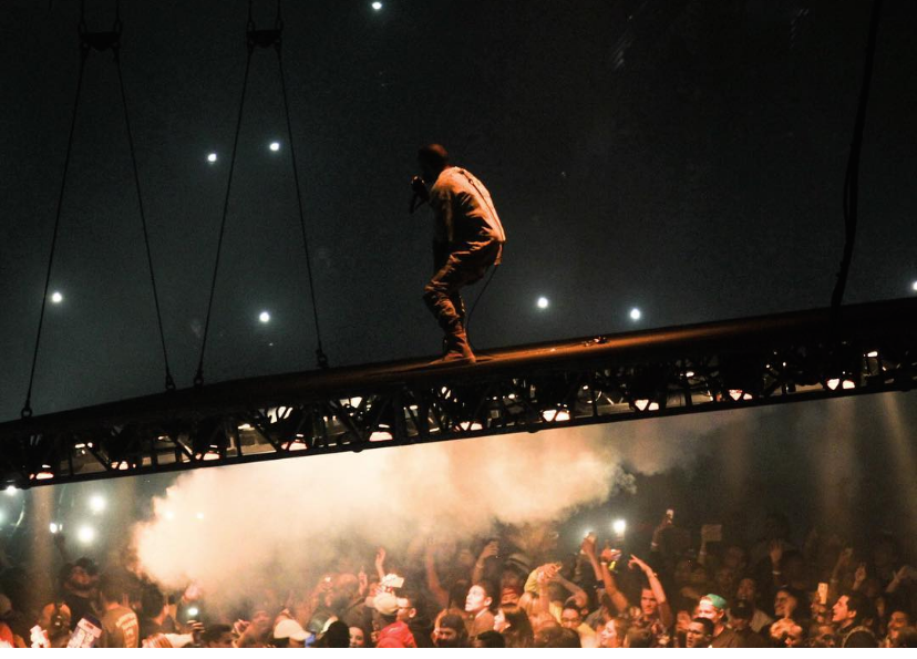 Kanye West looks out over the crowd from his floating stage as he performs at the United Center on Friday night.