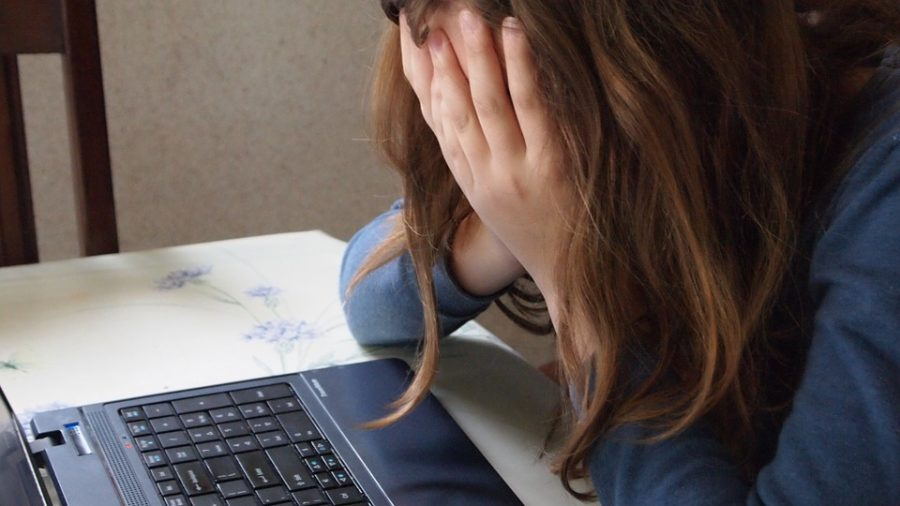 Students can combat cyberbullying by contacting social workers and reporting bullying behavior.
