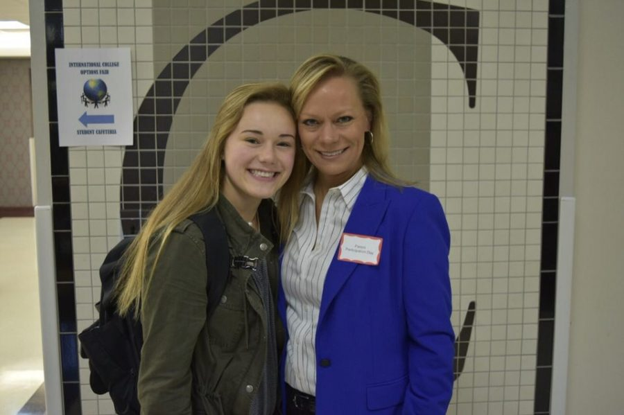 Kelly Nash, junior, poses with her mother in the hallway during Parent Participation Day.