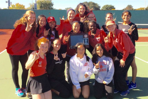 Girls' tennis team poses with an award during the 2016 season.