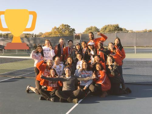 Girls' tennis pose after winning state on Oct. 22.