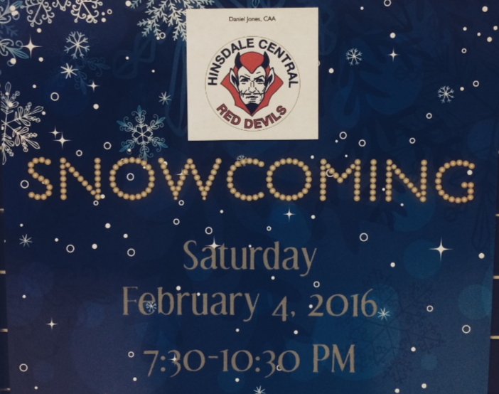 "Signs for the ""Snowcoming"" dance hosted by Varsity Club are hung around the school."