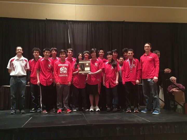 The Chess team receives their seventh place award at state.