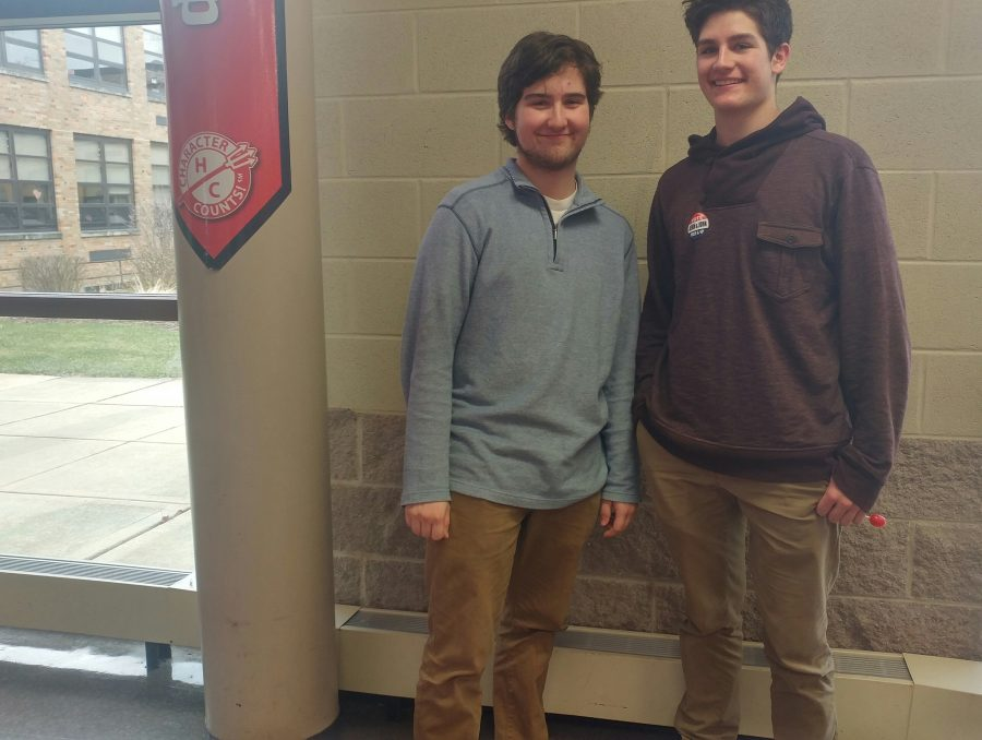 Students+Ben+Griffith%2C+senior%2C+and+Connor+Bower%2C+junior%2C+choose+khakis+and+colored+pullovers+for+a+spring+outfit.+