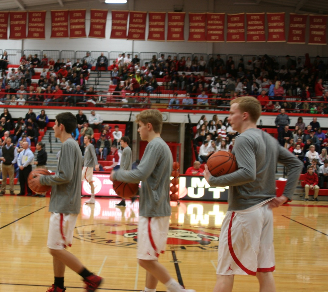 Central warms up before its home game against Lyons Township on Feb. 3.