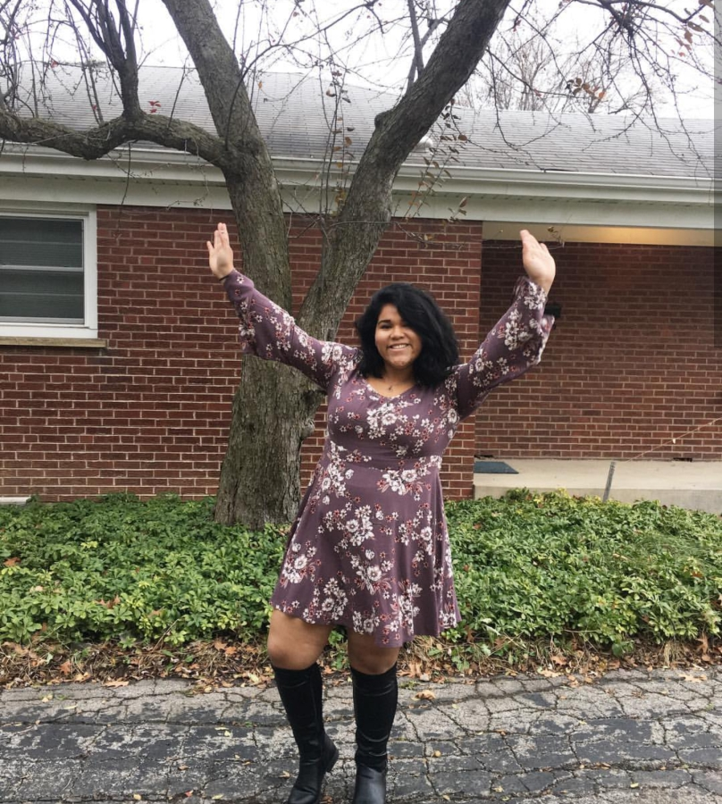 Chagoya pairs a floral bell-sleeved dress with a pair of high-rise boots.