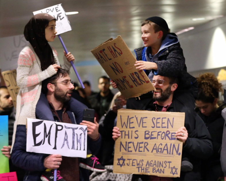 A young Muslim girl and Jewish boy protested the executive order together with their fathers on Saturday, Jan. 28 at Chicago O'Hare International Airport.