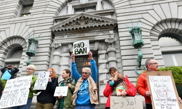 Protesters waited for a decision outside the Ninth Circuit Court of Appeals in San Francisco on Thursday, Feb. 9.