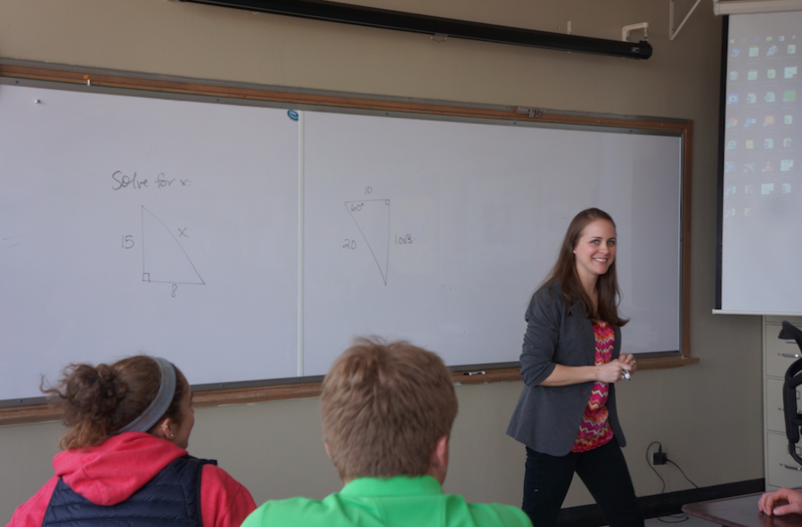 Ms. Green helps her algebra students prepare for their test tomorrow.