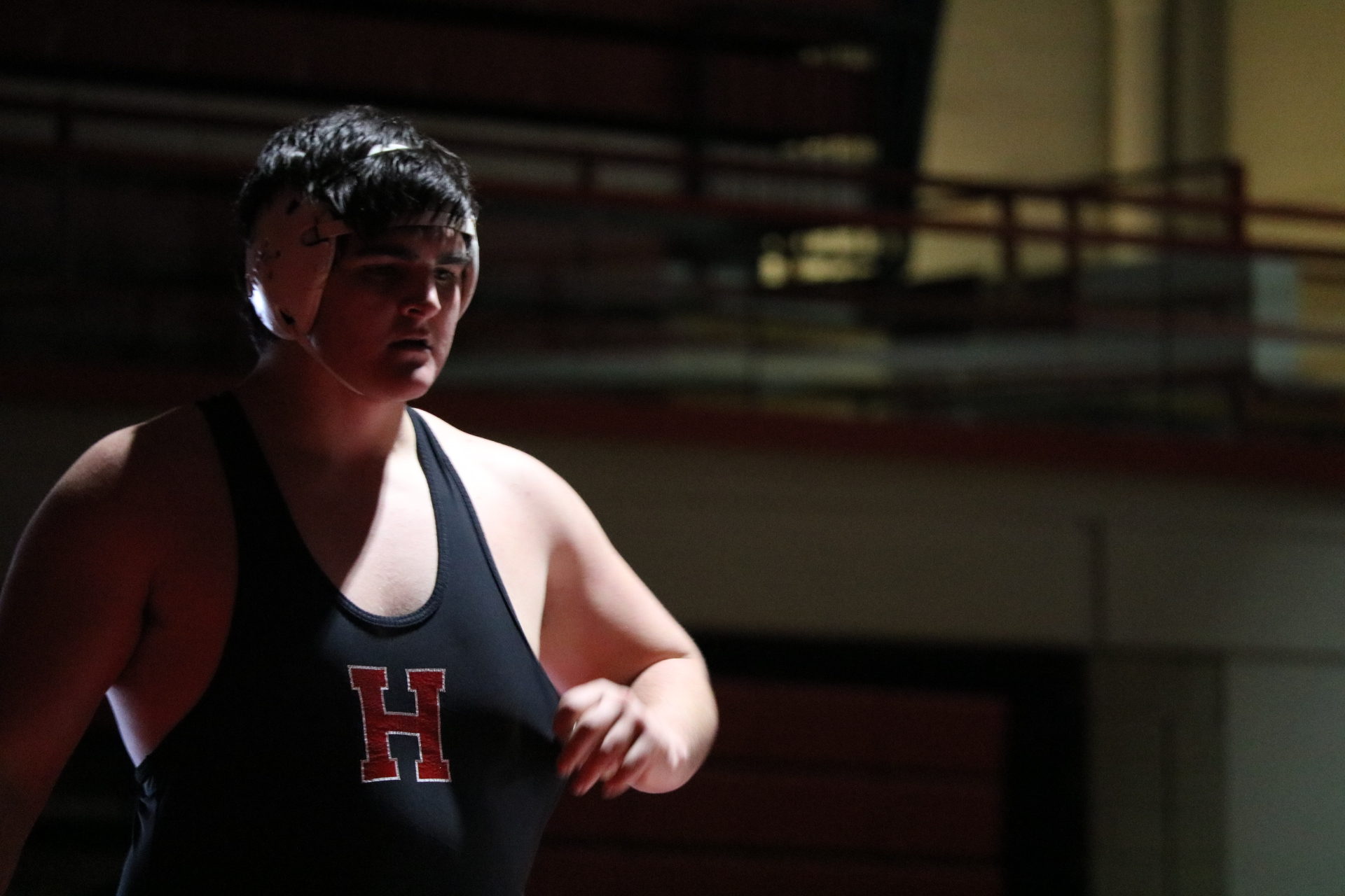 Niko Ivanisevic, senior, prepares to wrestle in the Hinsdale Central main gym.