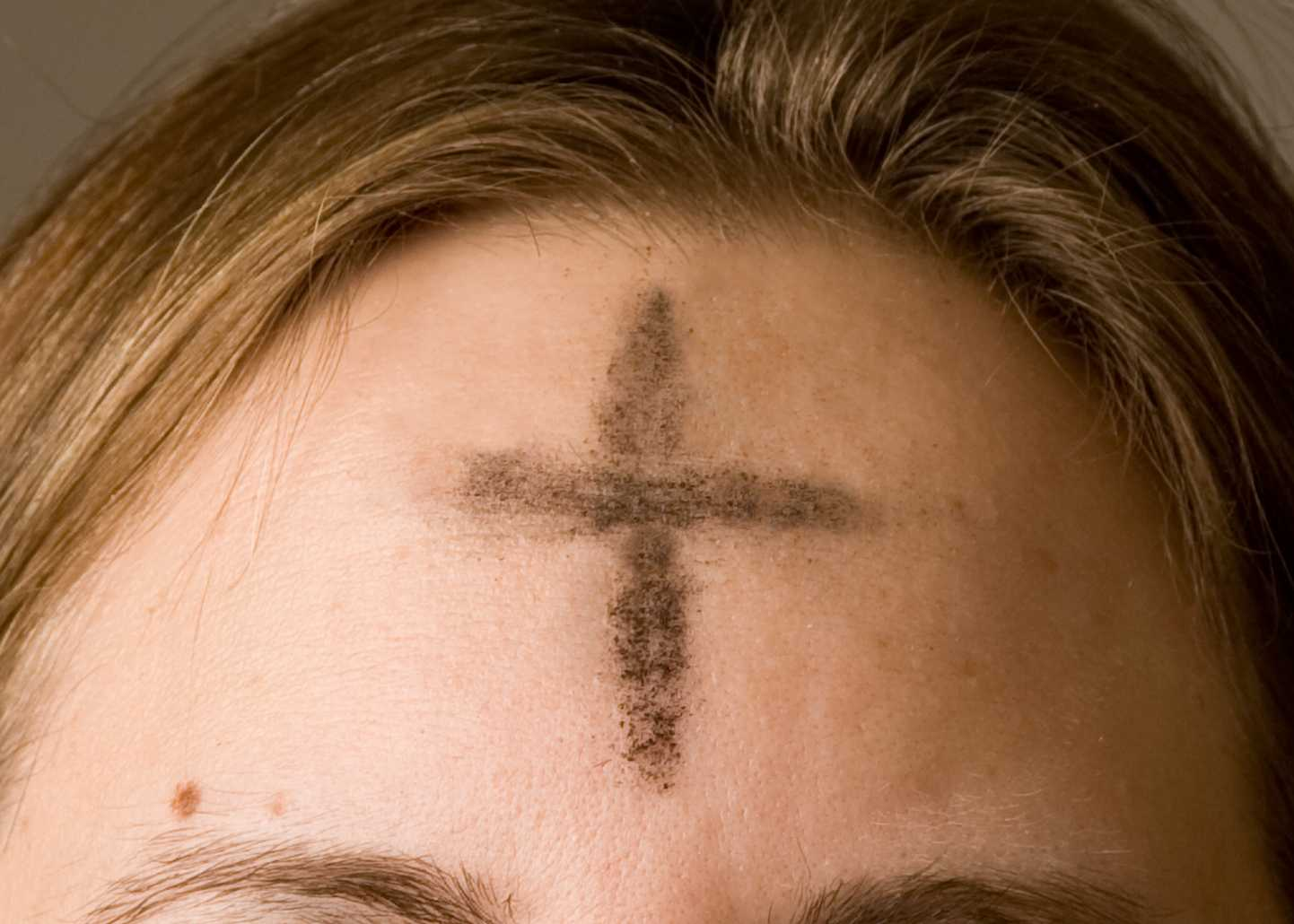 On Ash Wednesday every year, priests invite everyone to receive ashes in the shape of a cross on their forehead for the first day of Lent.