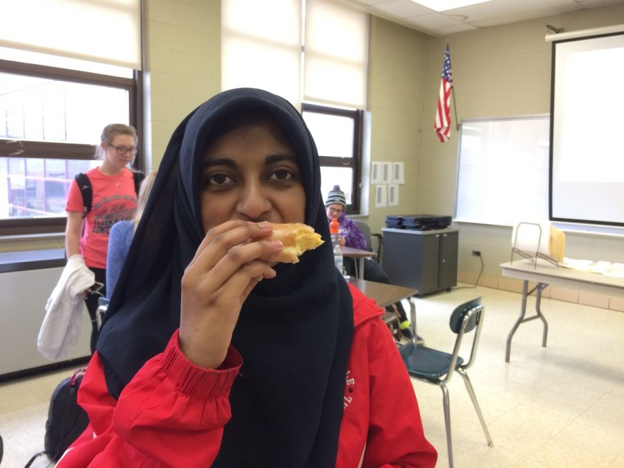 Sarah Vikaruddin, junior, enjoys a donut during her English class, like many students, because of their popularity in the cafeteria.