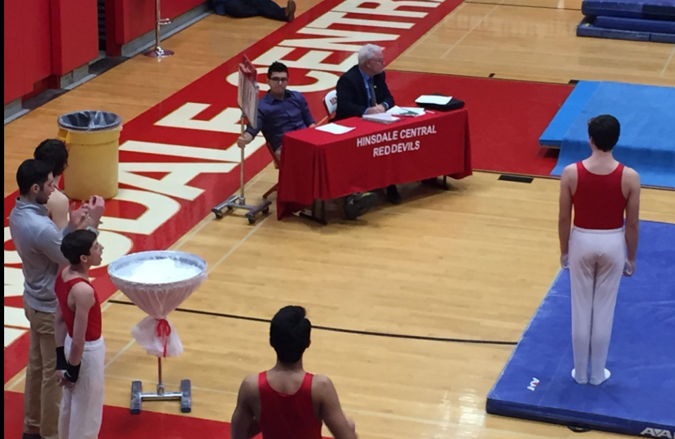Hinsdale Central gymnasts performs in front of a few judges.
