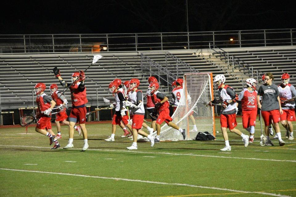 Boys' Varsity Lacrosse practices on Dickinson field on the evening of  March 8.
