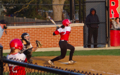 Shortstop Julia Chatterjee swings at a pitch on April 13. The team won 8-6 against Leyden High School.
