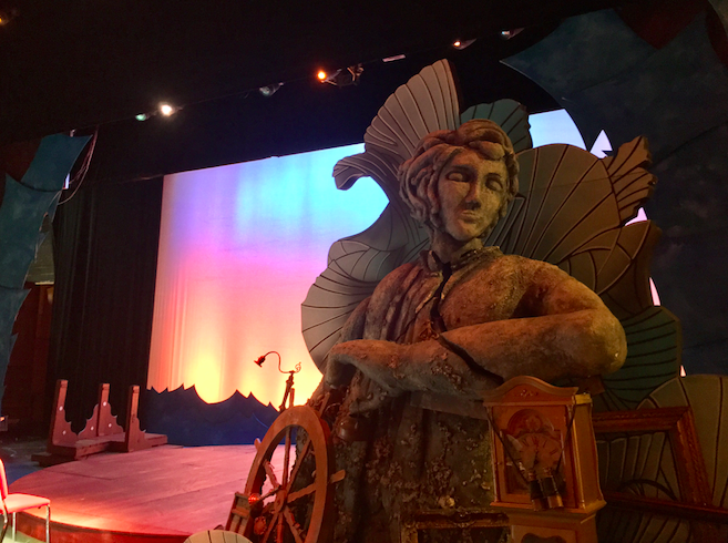 The set of Hinsdale Central's production of The Little Mermaid includes a statue of Prince Eric, a boat, and other pieces.