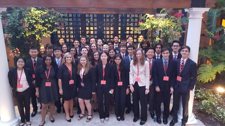 On+May+7%2C+students+stand+in+suits+in+front+of+the+Disney+Swan+Hotel%2C+ready+to+compete+in+their+main+events.+