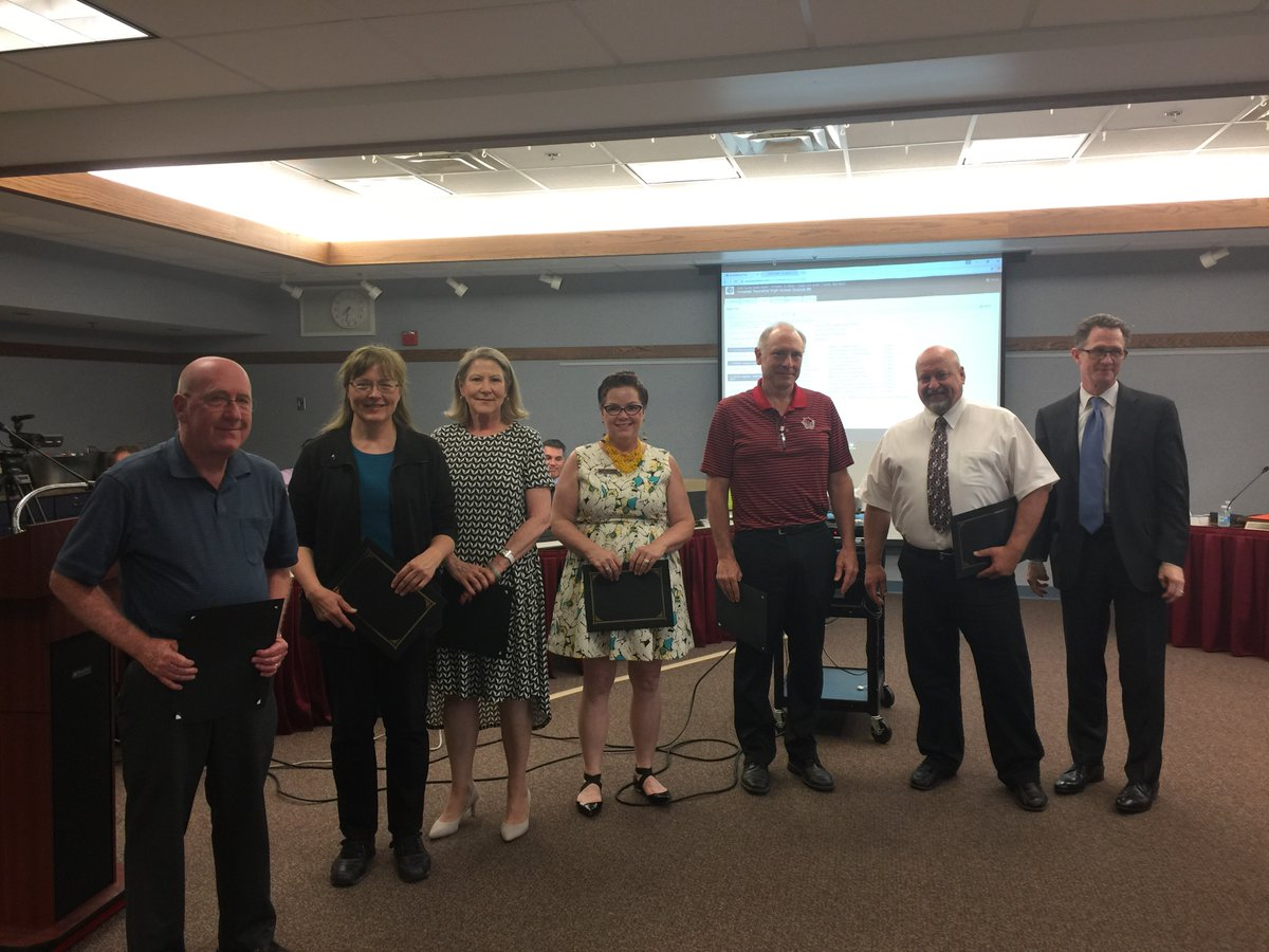 Technology education teacher Mr. Jess Krueger (third from right), art teacher Mrs. Patricia Potokar (middle), and science teacher Mr. Randy Gawlik (second from left) stand among other District 86 retirees.