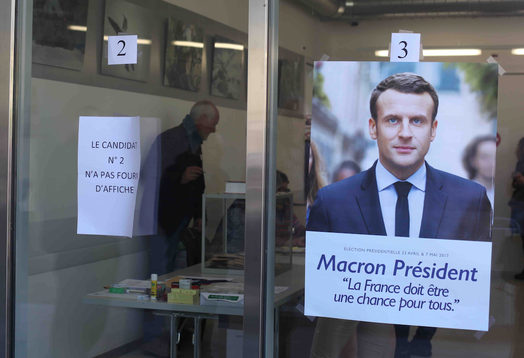 A+voting+station+for+French+citizens+in+Switzerland+showcased+the+different+candidates%2C+featuring+Emmanuel+Macron+prominently.
