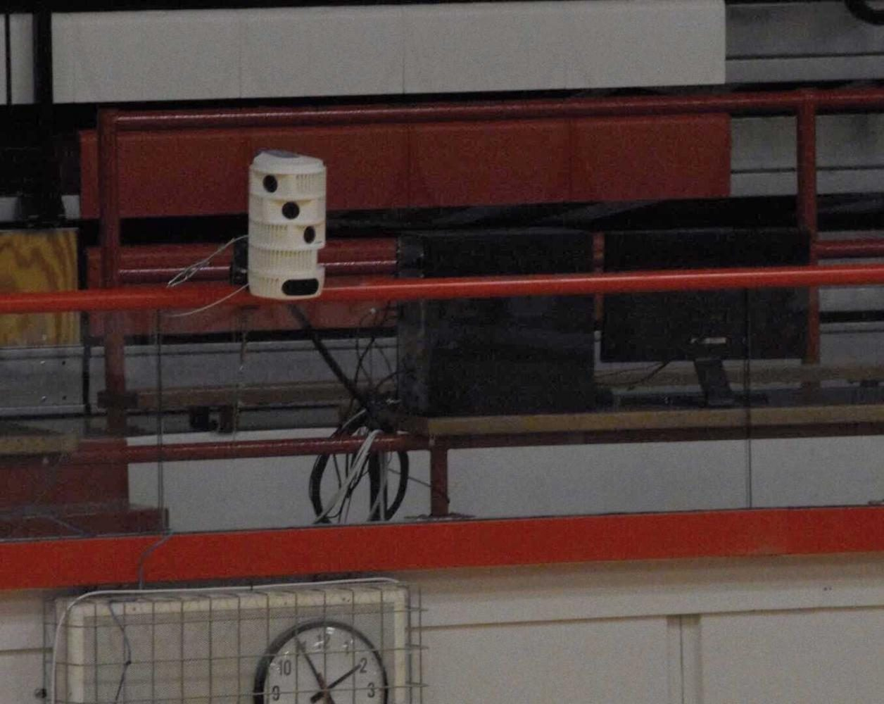 A set of the cylinder-shaped cameras can also be found just above the womens locker room entrance in the main gym.