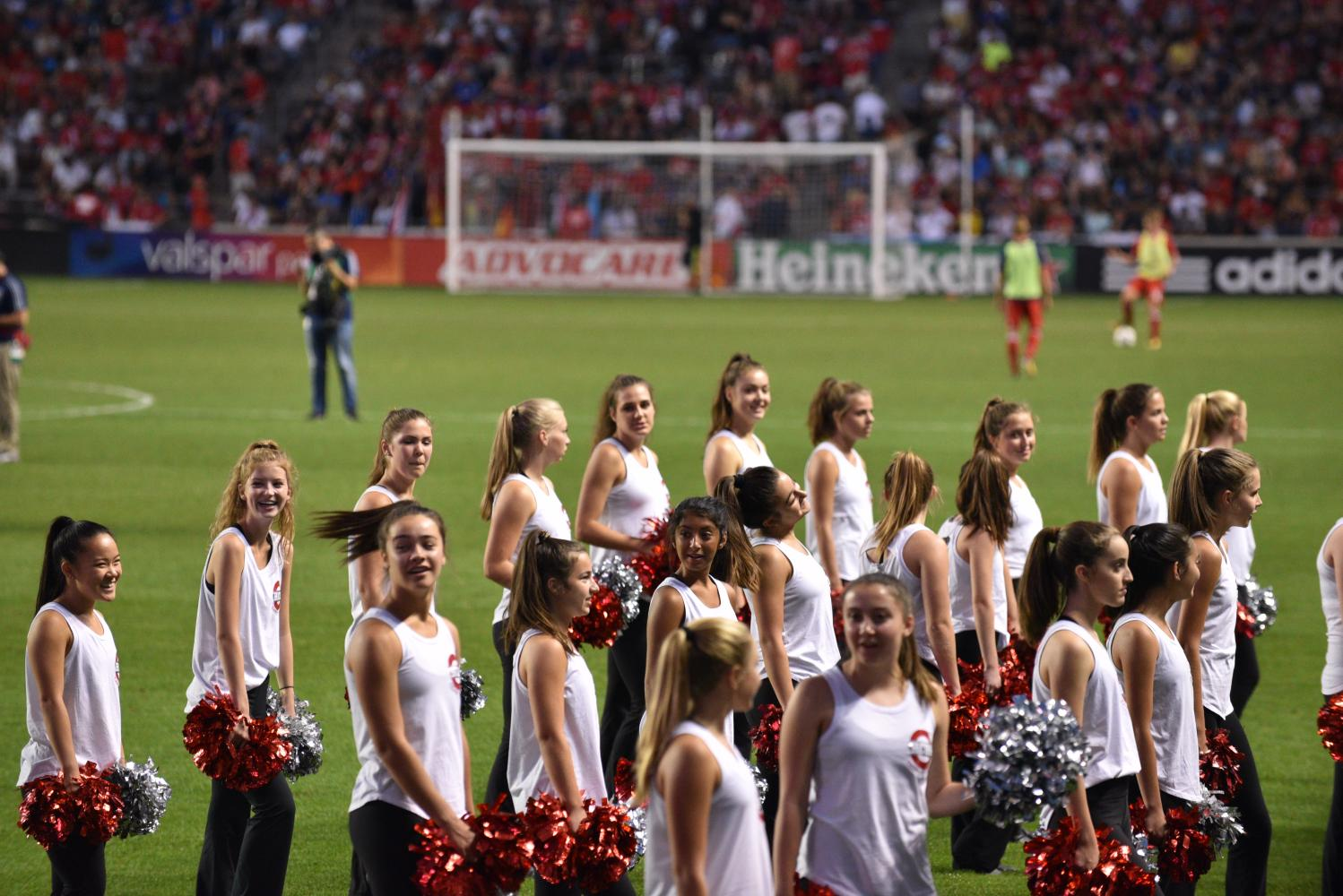 The poms team gets ready to perform in front of large crowd at Toyota Park during the halftime Chicago Fire game.