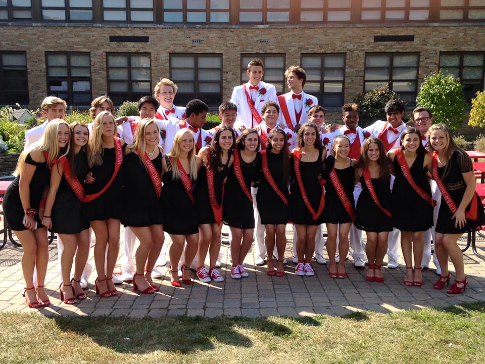 Court members pose in the courtyard for red and white day on Sept. 15, after performing skits at the pep assembly.