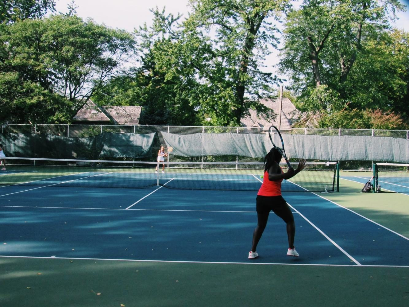 Layo+Adelakun%2C+junior%2C+prepares+to+return+the+ball+back+to+her+opponent+at+the+match+against+Glenbard+West+on+Sept.+12.