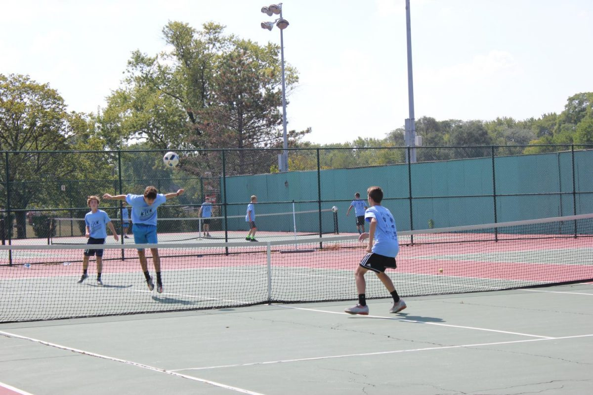 Members of the boys soccer team participated in a creative soccer-tennis hybrid in a fundraiser for the victims of Hurricane Harvey.
