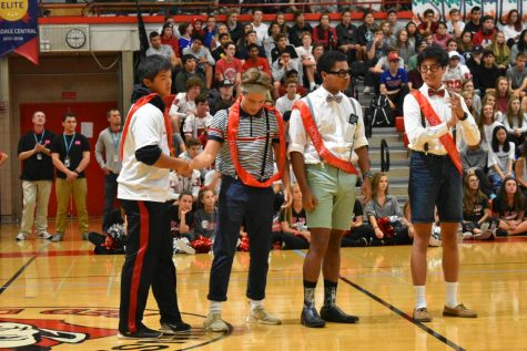 Homecoming king candidates (left to right) Kevin Qin, Tomas Baliutavicius, Joel Guerra, and Alex Choi stand in front of students after their place on court was announced.