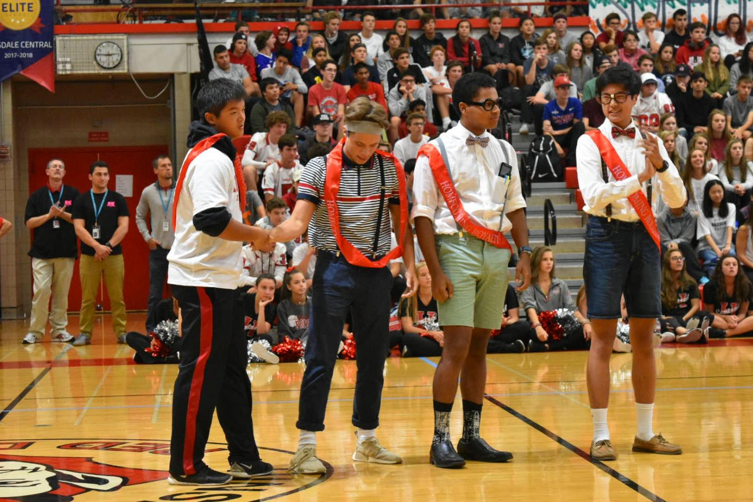 Homecoming+king+candidates+%28left+to+right%29+Kevin+Qin%2C+Tomas+Baliutavicius%2C+Joel+Guerra%2C+and+Alex+Choi+stand+in+front+of+students+after+their+place+on+court+was+announced.