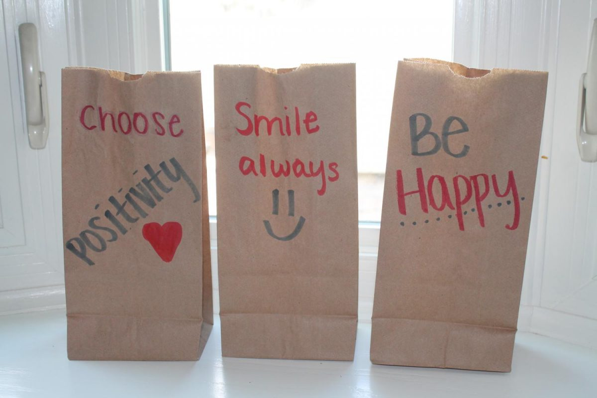 Students draw hopeful messages and designs on the bags that they pass out.