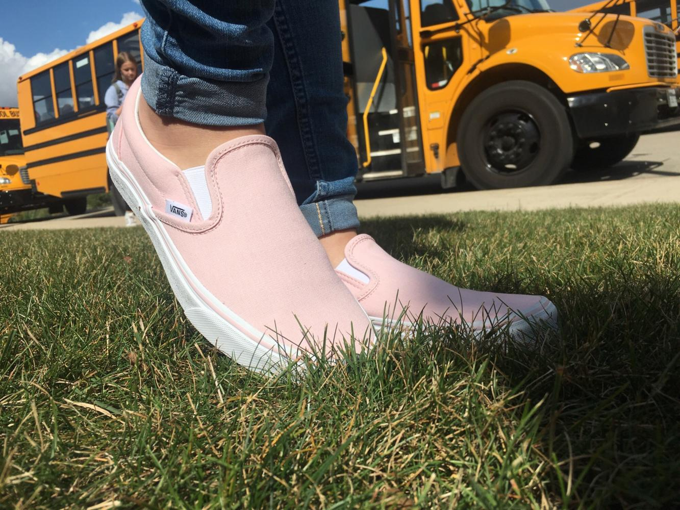 A student models a pair of Vans and jeans, the latest fall fashion.