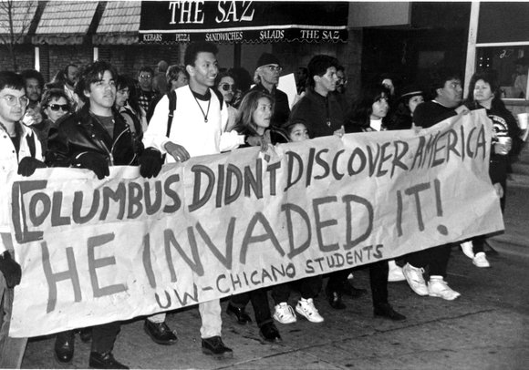 Americans with Native heritage protest the existence of Columbus Day.