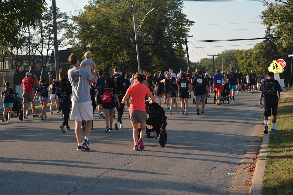 Community members walk through the streets of Hinsdale during the Habitat for Humanity 5K.