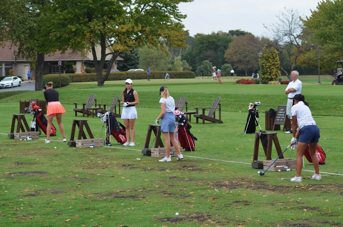 By practicing their shots and putts, girls varsity golf works hard at Ruth Lake to secure their spot as hopeful state champions.