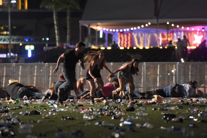 Music+festival+attendees+run+and+take+cover+after+hearing+shots+fired+into+the+crowd+on+Oct.+1+when+Stephen+Paddock%2C+64%2C+opened+fire+on+the+concert+attendees%3B+no+motive+has+been+found.+