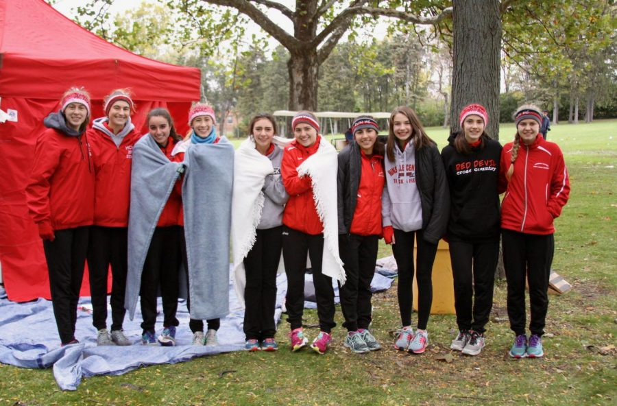 The girls varsity cross country team before their race at Sectionals