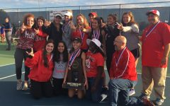 The girls varsity tennis team poses with their third place trophy at State Finals.