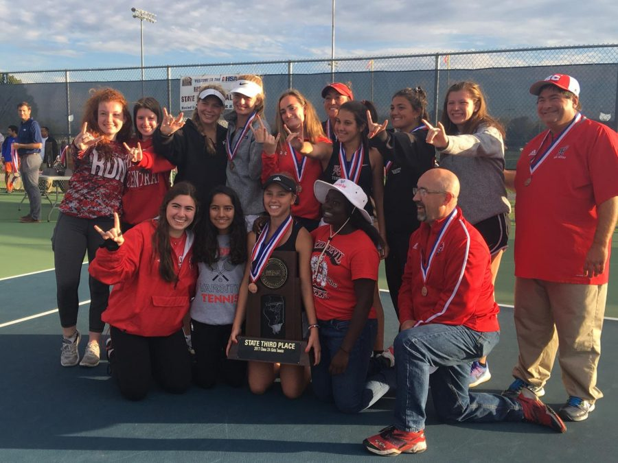 The+girls+varsity+tennis+team+poses+with+their+third+place+trophy+at+State+Finals.