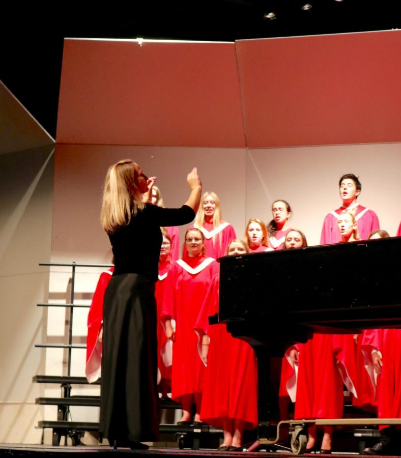 Choir Director Mrs. Jennifer Burkemper directs Hinsdale Central Singers.