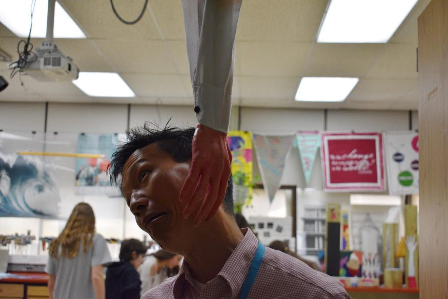 With+all+of+the+Halloween+decorations+being+put+up+around+the+school%2C+teachers+and+students+are+getting+into+the+spirit.+Mr.+Liaw+of+the+Science+Department+decided+to+put+up+a+fake+bloody+hand.