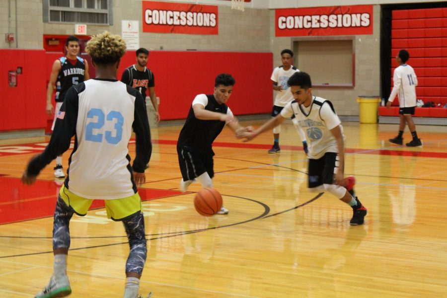 Mohammad Faizan from Willowbrook High School warms up for the game with his team members.