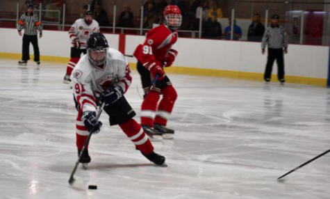 Rocky Araujo, junior, handles the puck during the game on Saturday, Oct. 7. Araujo was responsible for both of the team