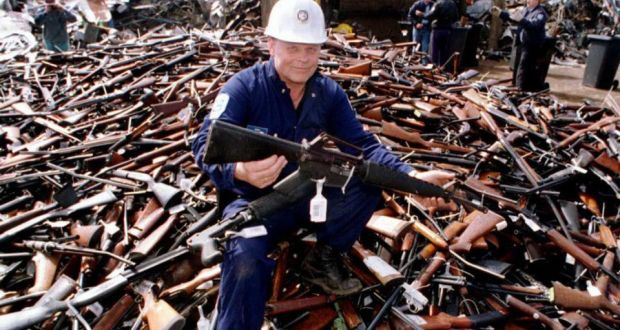 Norm Legg, project supervisor, holds up one of the many rifles collected in Melbourne for scrap on Sept. 8, 1996, after Australia banned all automatic and semi-automatic rifles in response to the massacre.