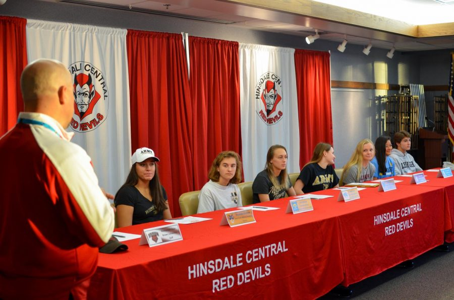 The+college+signing+was+led+by+Mr.+Dan+Jones%2C+athletic+director%2C+pictured+left%2C+on+Wednesday%2C+Nov.+8.+Eight+students+signed+to+various+colleges+for+athletic+scholarships.++